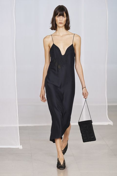 Fashion model, Clothing, Fashion show, Fashion, Dress, Shoulder, Runway, Cocktail dress, Neck, Little black dress,