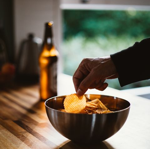 a man and potato chips, beer
