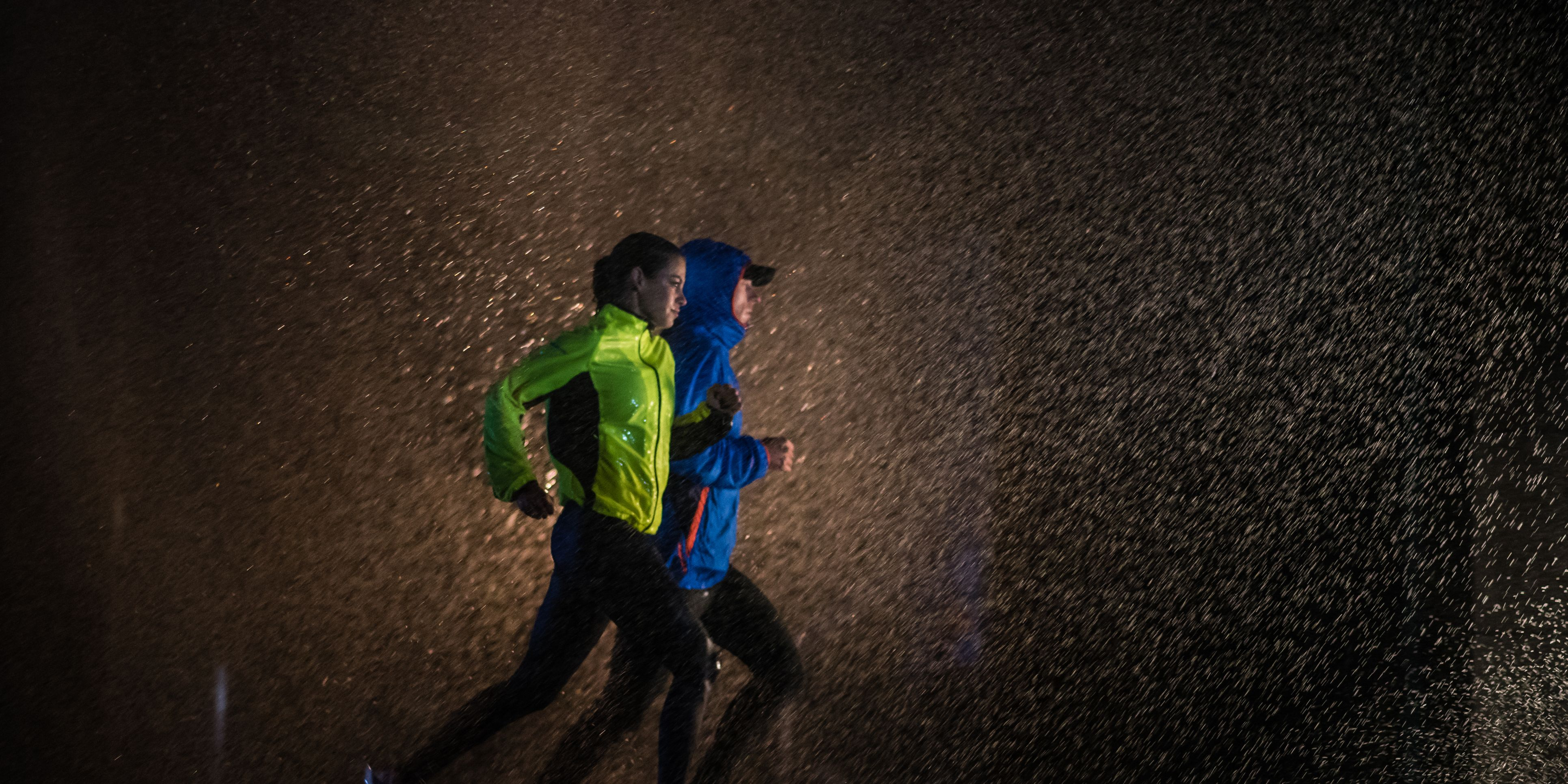 Man and woman jogging in city