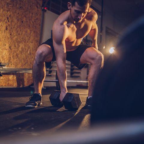 Man body building in gym