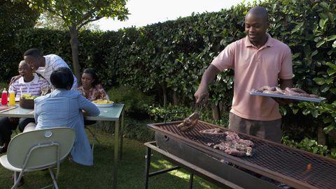 man braaing in the garden, johannesburg, south africa