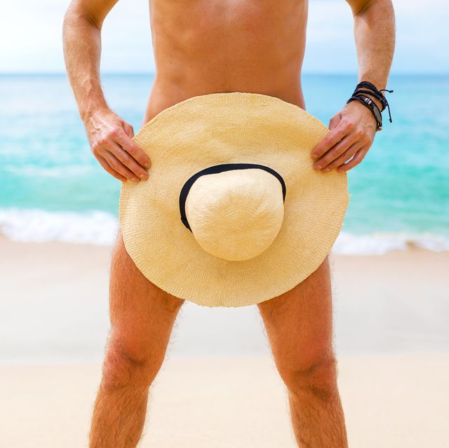 man covering himself with summer hat