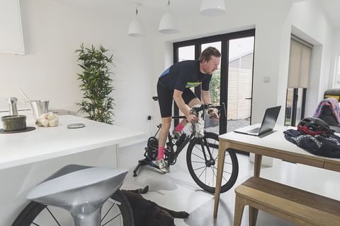 Man cycling on turbo trainer