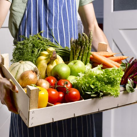 man delivering fruit and vegetable box