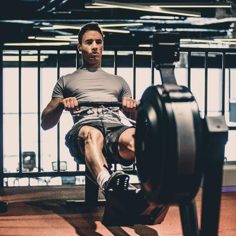 Man doing cardio workout on rowing machine