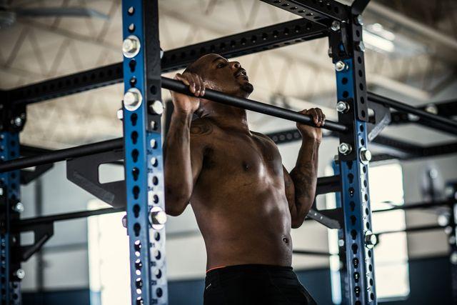 man doing pullups at cross training gym