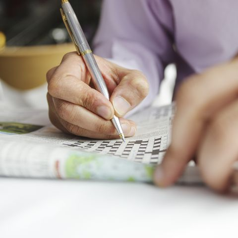 Man doing word cross at home