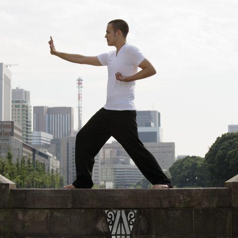 Man Doing Tai Chi Outdoors