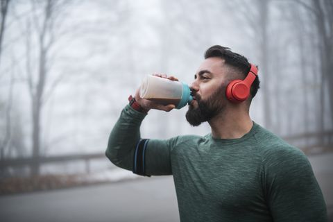 Man Drinking Energy Drink After Exercising.