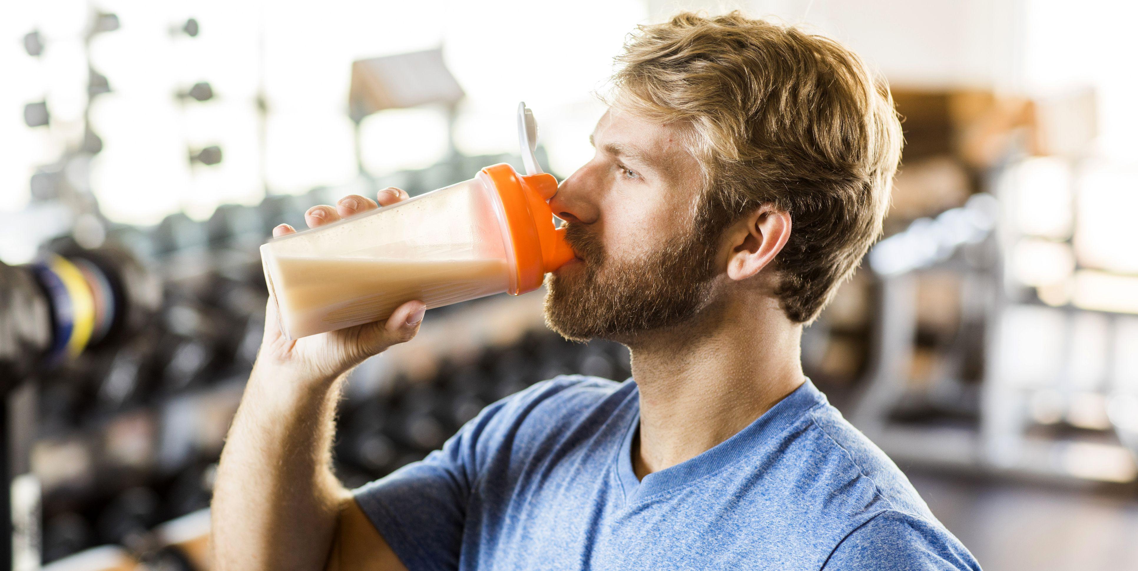 Man drinking protein drink.