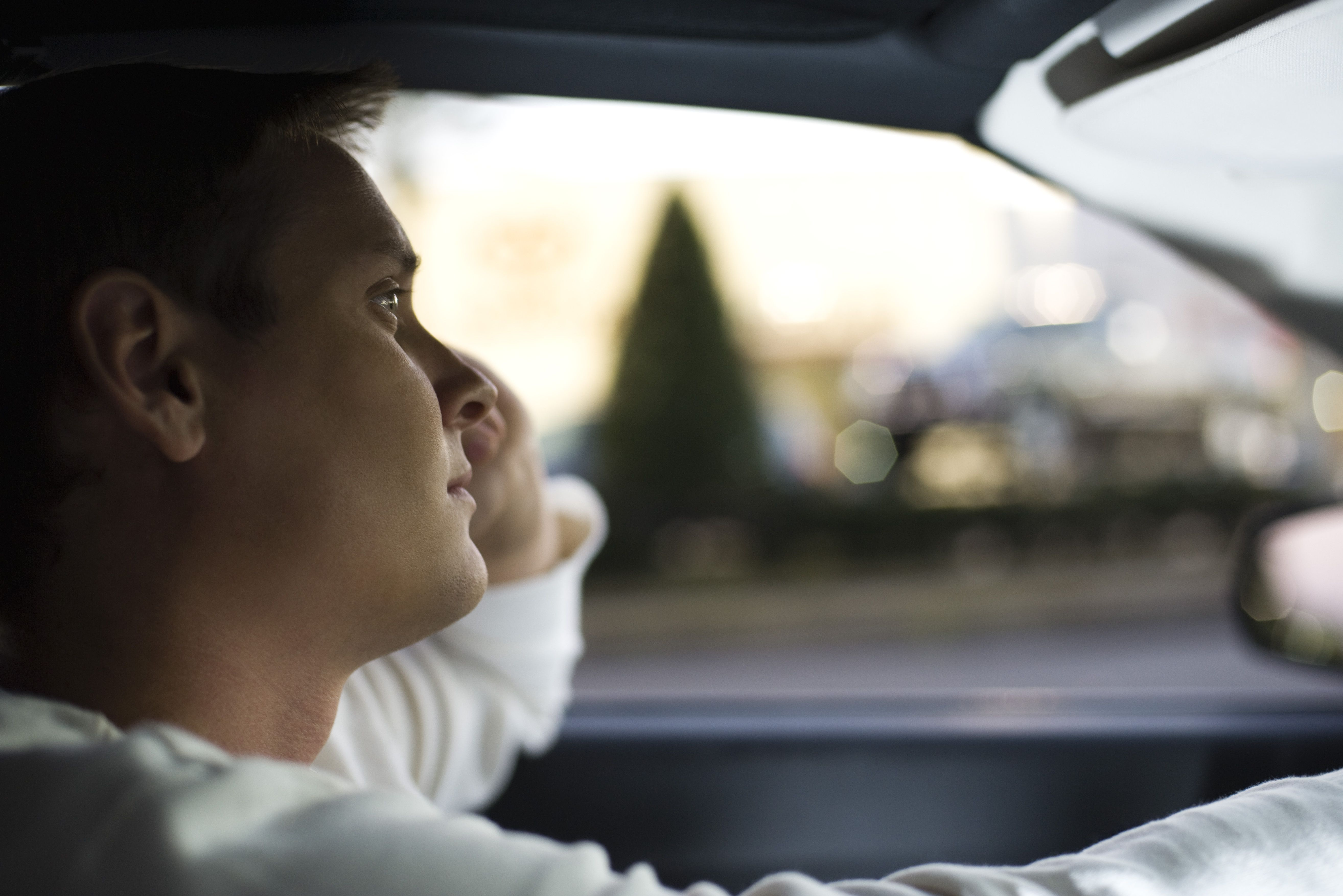 Man driving, lost in thought
