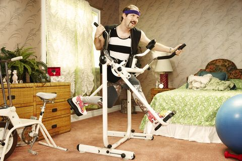 Man execising on vintage equipment in home gym