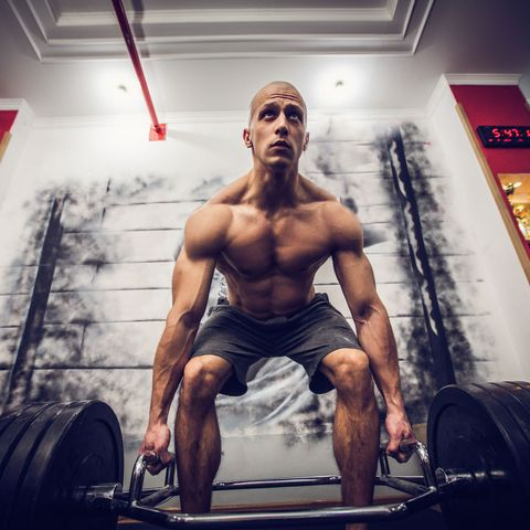 Man exercise with weights