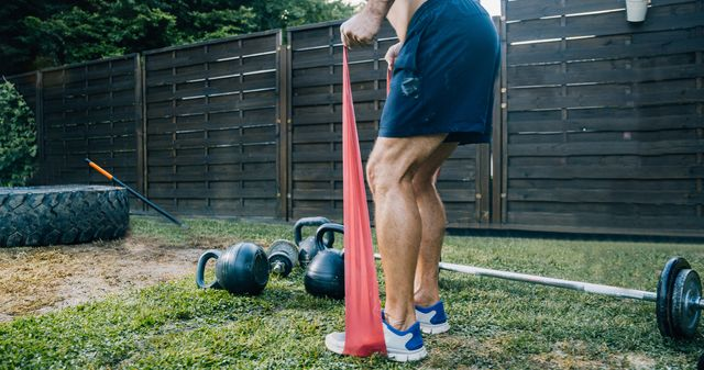 man exercising in front or back yard