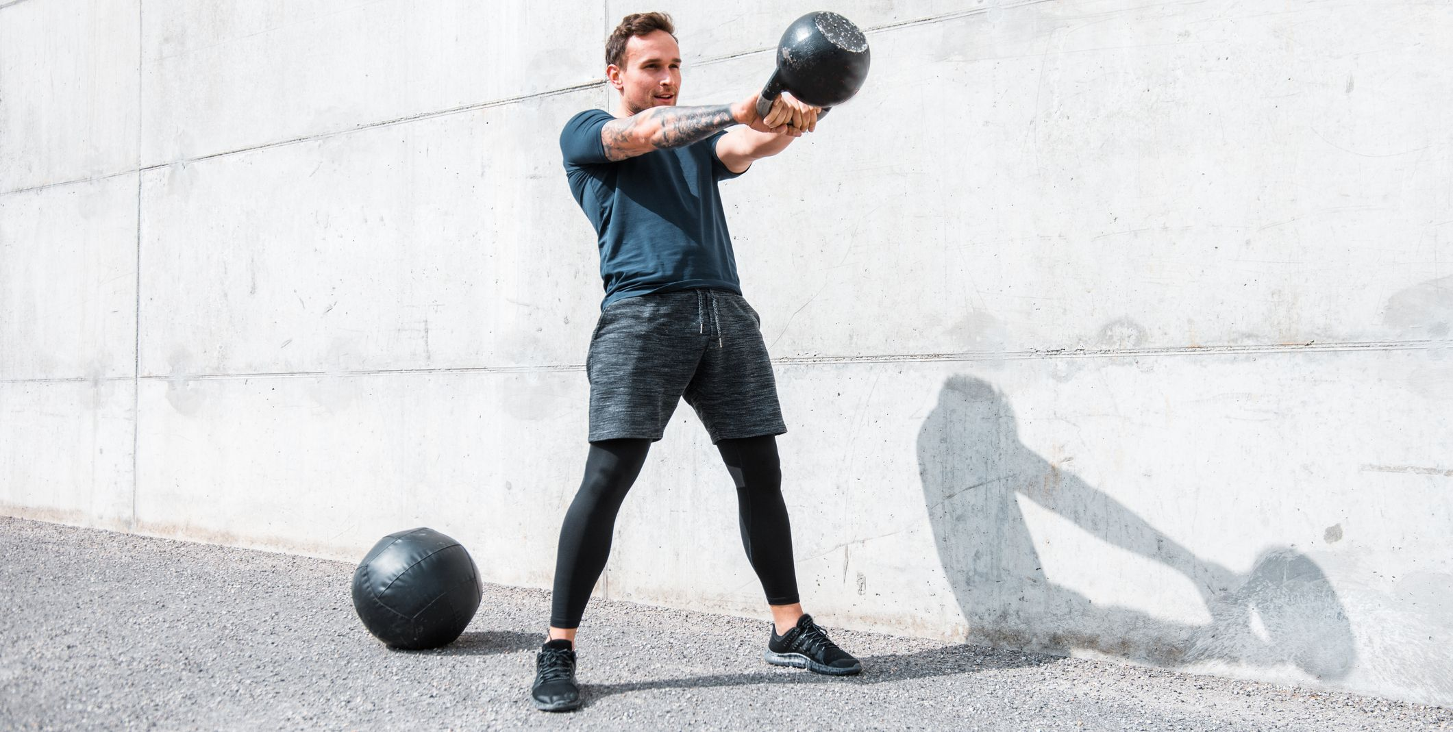 Man exercising with a kettlebell outdoors