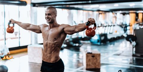 Man exercising with kettlebell in the gym