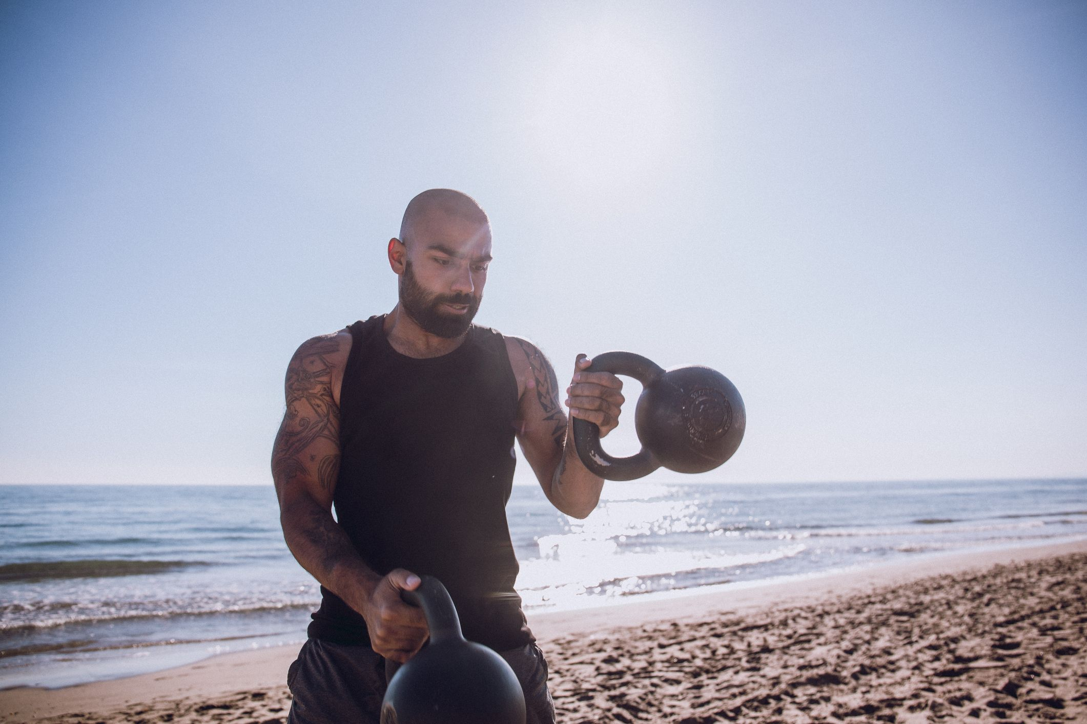 This 3-Move Push-Pull Kettlebell Workout Hits Your Whole Body