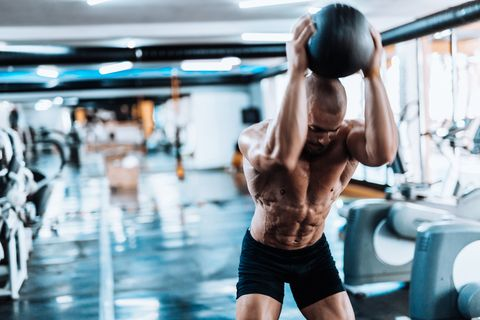 Man exercising with medicine ball in the gym
