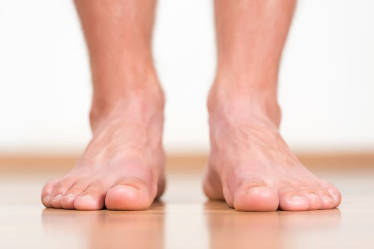 Man feet stepping on the flor