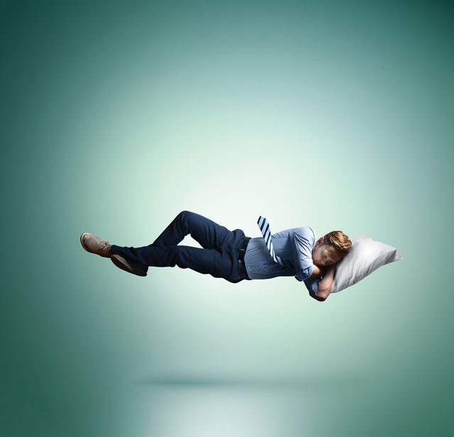 man floating in mid air, sleeping