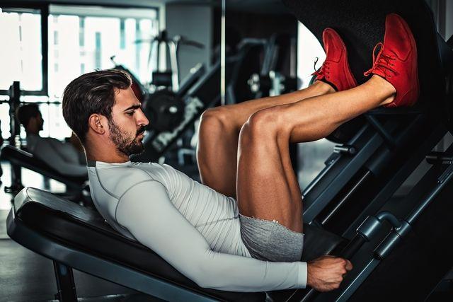 man doing leg exercises
