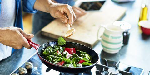 Man frying vegetables