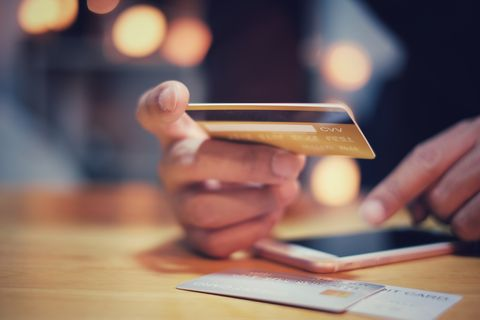 man hands holding using credit card for online shopping payment with smartphone