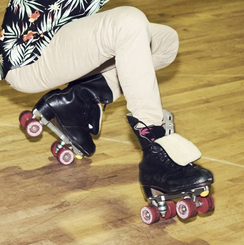 man having fun at roller disco