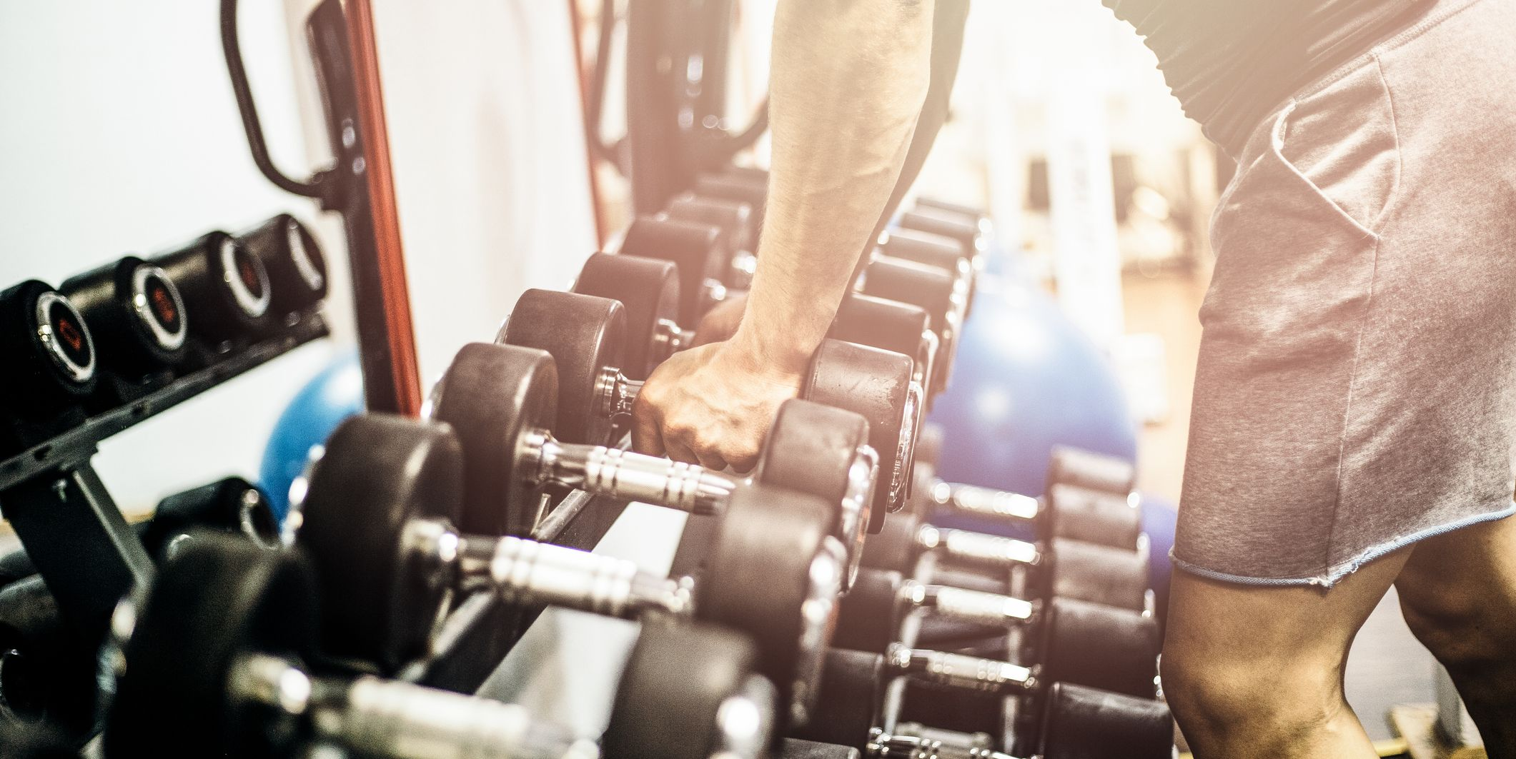 Man holding dumbbell in gym