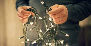 Man holding fairy lights.