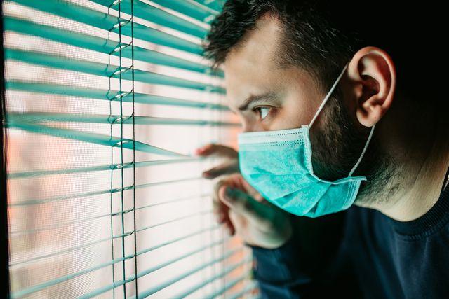 man in lockdown looking through the window