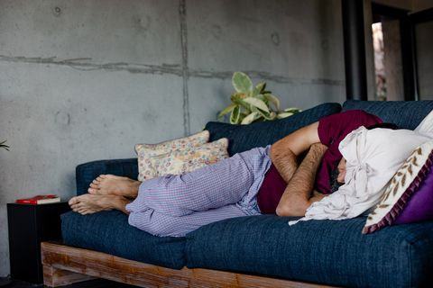 A man who was lying on a sofa and sleeping