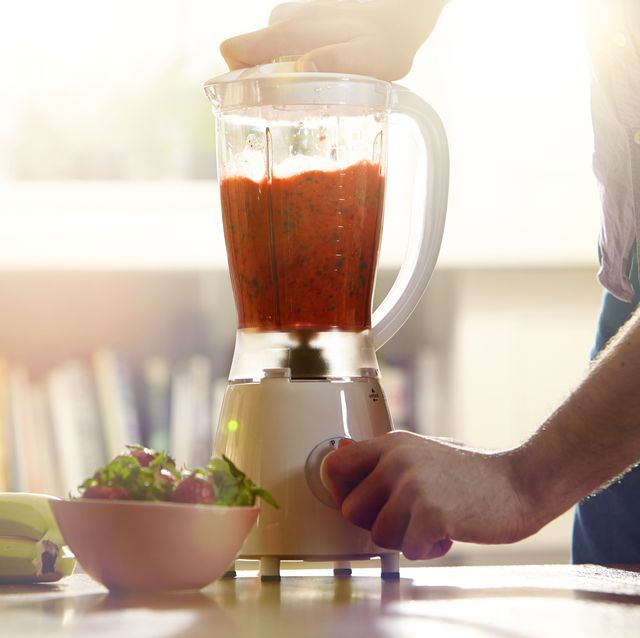 man making a smoothie at home