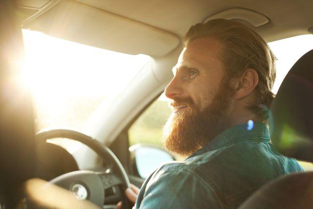 man on roadtrip driving car