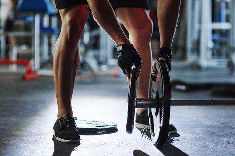 Man preparing barbell in gym