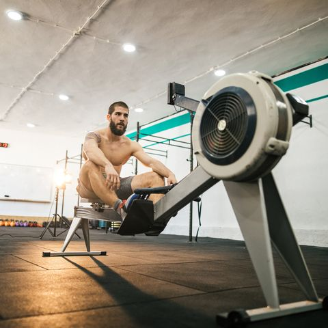 Man preparing for a rowing in the gym
