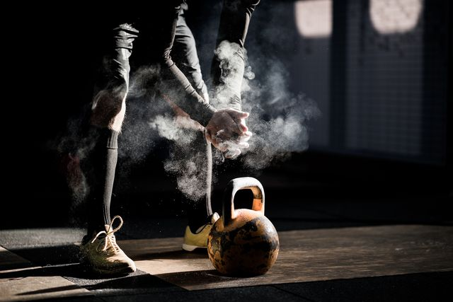 gym fitness workout man ready to exercise with kettle bell