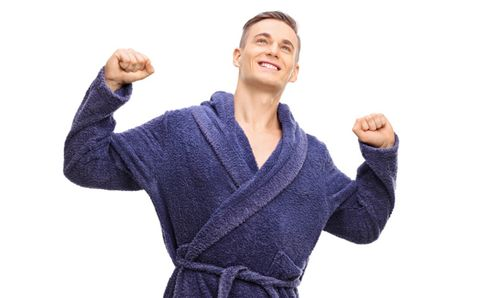man stretching in his bathrobe