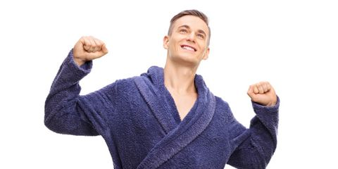 man stretching in his robe