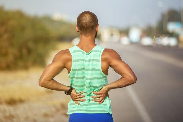 man runner lower back pain injury