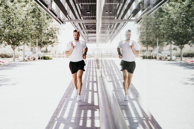 man running along a building