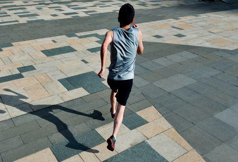 Man running in city street