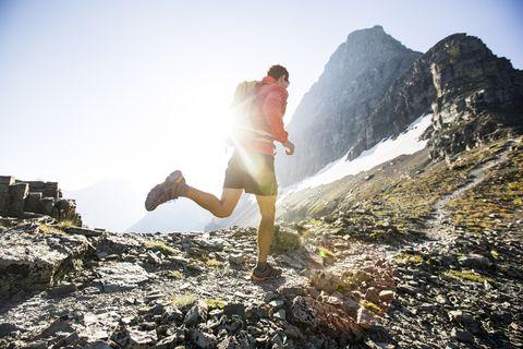 a man running in glacier park