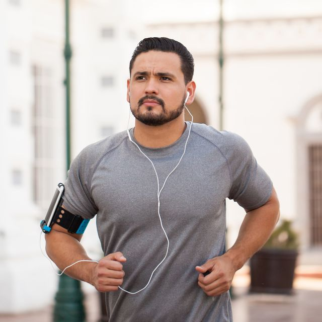 man running in the city and listening to music