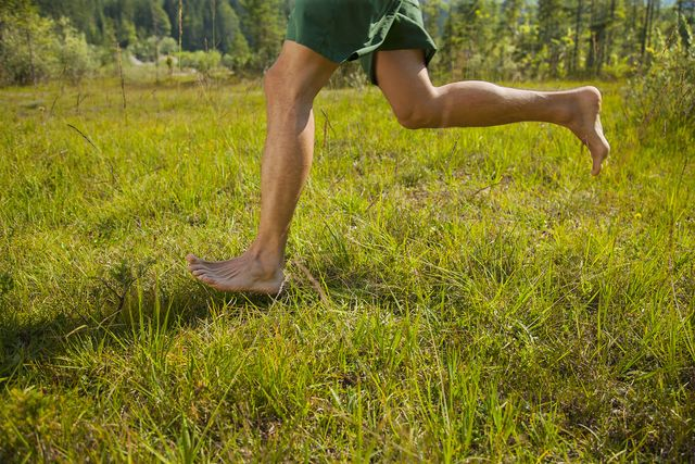 man running in the nature only lower extremities