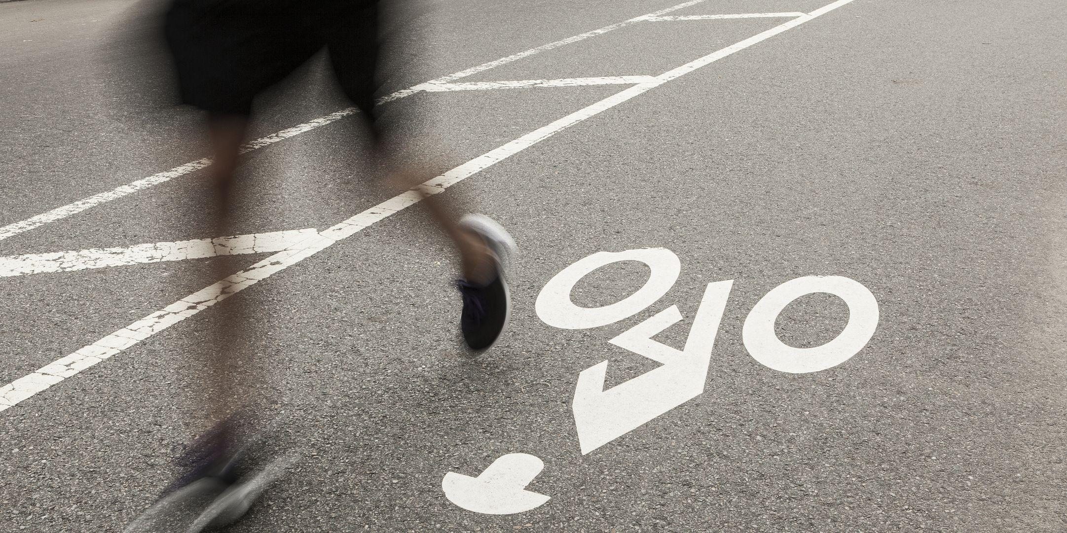 Man running on bike road