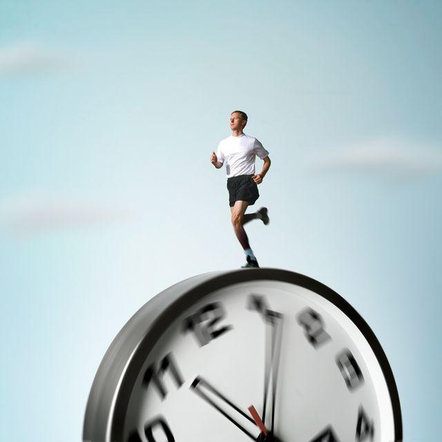 man running on rolling clock