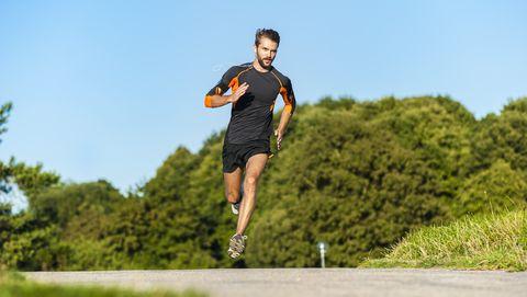 man running on rural path