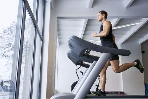 man running on treadmill at gym