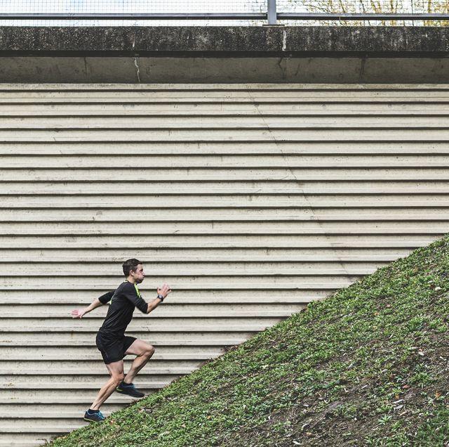 man running up steep hill